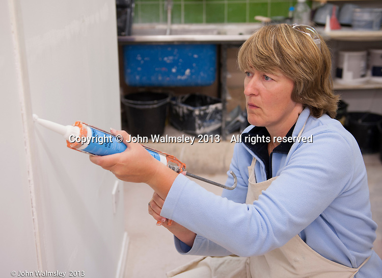 Female painting & decorating trainee,  Able Skills training centre, Dartford, Kent.