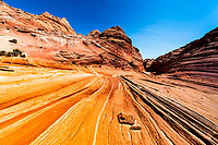 Colorful, sedimentary rocks near iconic The Wave formation, in North Coyote buttes of Paria Canyon, at the Arizona and Utah border USA