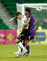 23rd May 2021; HBF Park, Perth, Western Australia, Australia; A League Football, Perth Glory versus Macarthur; Jonathan Aspropotamitis of Perth Glory grapples with Matthew Derbyshire of Macarthur FC in a heavy tackle