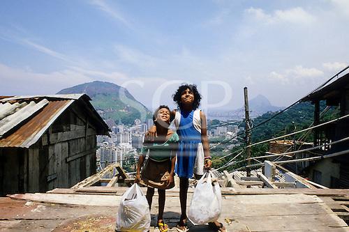 Rio de Janeiro, Brazil. Favela shanty town; two poor children from a shanty town.