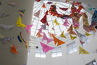 "A new art installation is shown, Friday, September 11, 2020 at Springdale High School in Springdale. About 600 Springdale High School art students and all of the art teachers created a large origami butterfly installation to hang in the school's rotunda. The theme is ""hope"", and each student wrote a personal hope or dream on origami paper then folded it into a butterfly. Check out nwaonline.com/200912Daily/ for today's photo gallery. <br /> (NWA Democrat-Gazette/Charlie Kaijo)"