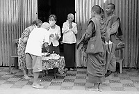 Battambang - Cambodia - June 2020<br />  - Riverside in early morning. Monks collecting alms