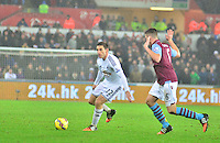 Pictured: Friday 26 December 2014<br /> Re: Premier League, Swansea City FC v Aston Villa at the Liberty Stadium, Swansea, south Wales, UK.<br /> <br /> Swansea's Angel Rangel on the ball.