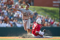 Texas Longhorns shortstop CJ Hinojosa (9) attempts to turn a double play in the ninth inning of the NCAA baseball game against the Houston Cougars on June 6, 2014 at UFCU Disch–Falk Field in Austin, Texas. The Longhorns defeated the Cougars 4-2 in Game 1 of the NCAA Super Regional. (Andrew Woolley/Four Seam Images)