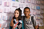 Education High School public male and female student posing in corridor