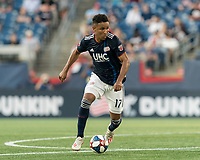 FOXBOROUGH, MA - JUNE 26: Juan Agudelo #17 dribbles at midfield during a game between Philadelphia Union and New England Revolution at Gillette Stadium on June 26, 2019 in Foxborough, Massachusetts.
