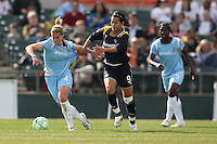 Han Duan (right) grabs Jen Buczkowski (left). Los Angeles Sol defeated Sky Blue 2-0 in Bridgewater, NJ on Sunday, April 5, 2009. Photo by Robyn McNeil/isiphotos.com