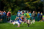 St Senans Cillian Trant under pressure from Ronán Collins of Gneeveguilla in the County Premier Junior football Quarter Final
