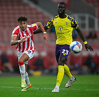 21st November 2020; Bet365 Stadium, Stoke, Staffordshire, England; English Football League Championship Football, Stoke City versus Huddersfield Town; Jacob Brown of Stoke City chases a loose ball in front of Naby Sarr of Huddersfield Town