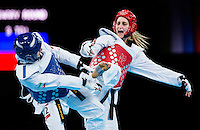 10 AUG 2012 - LONDON, GBR - Carmen Marton (AUS) (right) of Australia aims a kick at Sousan Hajipourgoli of Iran during their women's -67kg category preliminary round contest at the London 2012 Olympic Games Taekwondo at Excel in London, Great Britain .(PHOTO (C) 2012 NIGEL FARROW)