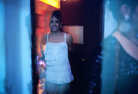 Dressed in white fringe, a female impersonator entertains the audience at Castropol nightclub, a cabaret located across from the Malecon in Havana. Attitudes toward gays and lesbians have relaxed in recent years, and the drag queen show attracts a loyal crowd.