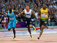 05 AUG 2012 - LONDON, GBR - Derrick Atkins (BAH) (left) of the Bahamas and Adam Gemili (GBR) (centre) of Great Britain dive for the line as Yohan Blake (JAM) (right) of Jamaica wins their men's 100m semi final during the London 2012 Olympic Games athletics in the Olympic Stadium at the Olympic Park in Stratford, London, Great Britain (PHOTO (C) 2012 NIGEL FARROW)