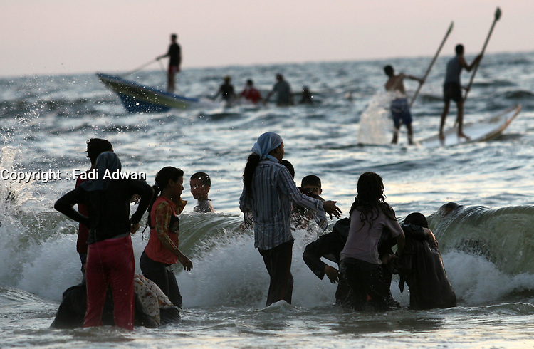 """Palestinians enjoy a day at the beach in Gaza City,14.Augest. 2007. Two months after Hamas took over the territory, Palestinians head to the beach, Hamas leaders preach in mosques and rival Fatah members accuse them of establishing an Islamic state.""""photo by Fady Adwan"""""""