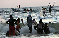 "Palestinians enjoy a day at the beach in Gaza City,14.Augest. 2007. Two months after Hamas took over the territory, Palestinians head to the beach, Hamas leaders preach in mosques and rival Fatah members accuse them of establishing an Islamic state.""photo by Fady Adwan"""