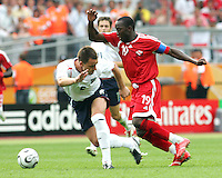 Dwight Yorke of Trinidad has John Terry of England going the wrong way. England defeated Trinidad & Tobago 2-0 in their FIFA World Cup group B match at Franken-Stadion, Nuremberg, Germany, June 15 2006.