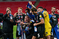 Northampton Town players celebrates promotion to League One with the trophy after a 4-0 victory in the Sky Bet League 2 PLAY-OFF Final match between Exeter City and Northampton Town at Wembley Stadium, London, England on 29 June 2020. Photo by Andy Rowland.