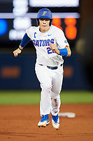 Florida Gators catcher JJ Schwarz (22) running the bases during a game against the Siena Saints on February 16, 2018 at Alfred A. McKethan Stadium in Gainesville, Florida.  Florida defeated Siena 7-1.  (Mike Janes/Four Seam Images)