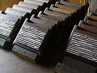 Stacked letterpress lead in the workshop of the Dale Guild Foundry.