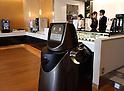 Panasonic's transport robot HOSPI in action at Narita International Airport