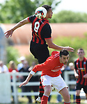Johnny Okoro of Bridge United A in action against Stephen Kelly of Newmarket Celtic A during their Clare Cup Final at Frank Healy Park. Photograph by John Kelly.