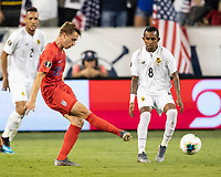 KANSAS CITY, KS - JUNE 26: Djordje Mihalovic #20 passes the ball past Marcos Sanchez #8 during a game between Panama and USMNT at Children's Mercy Park on June 26, 2019 in Kansas City, Kansas.