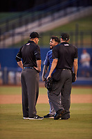 AZL Rangers manager Carlos Cardoza (65) argues with umpires Larry Dillman Jr. (left) and Tyler Wall (right) after being ejected during an Arizona League game against the AZL Brewers Blue on July 11, 2019 at American Family Fields of Phoenix in Phoenix, Arizona. The AZL Rangers defeated the AZL Brewers Blue 5-2. (Zachary Lucy/Four Seam Images)