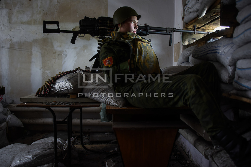 A Russia-backed rebel looking though firing port at his position near Donetsk, Eastern Ukraine, May 26, 2015