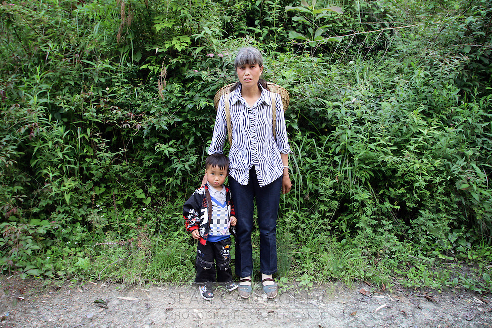 A woman and child in the forests of Pingwu County in northern Sichuan Province, south-west China.