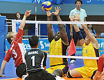 November 18 2011 - Guadalajara, Mexico:  Austin Hinchey of Team Canada spikes the ball while taking on Columbia in the Bronze Medal Game in the Pan American Volleyball Complex at the 2011 Parapan American Games in Guadalajara, Mexico.  Photos: Matthew Murnaghan/Canadian Paralympic Committee