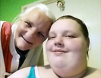Pictured: Georgia Davis (R) with her mum Lesley (L).<br /> Re: A woman once dubbed Britain's fattest teen has split up from her boyfriend Matthew Takel.<br /> Georgia Davis made headlines when she had to be moved out of her house in Aberdare, south Wales, with the help of the emergency services.