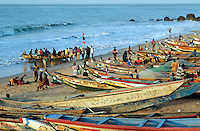 Gambia. Bakau. Atlantic ocean. Bakau is 15 km away from the capital Banjul.  Fishermen and their boats on the beach at sunset. © 2000 Didier Ruef
