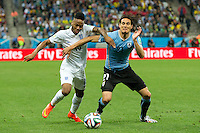 Raheem Sterling of England takes on Edinson Cavani of Uruguay