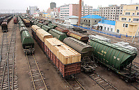 Loads of processed wood materials ready to export to the Russian territories, are seen in the Manzhouli railway station, Inner Mongolia, China. China is increasingly importing more and more of the world's natural resources while exporting more processed goods to the many countries..29 May 2008