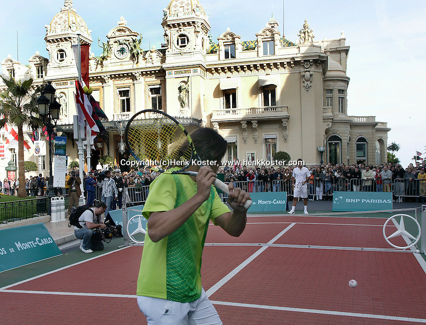 16-4-06, Monaco, Tennis,Master Series, Nadal (foreground)returns the bal to Federer in front of the Casino in Monte Carlo to make the openings act for the tournament