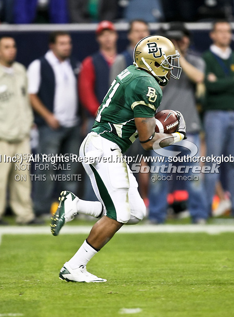 Baylor Bears running back Jarred Salubi (21) in action during the 2010 Texas  Bowl football game between the Illinois  Fighting Illini and the Baylor Bears at the Reliant Stadium in Houston, Tx. Illinois defeats Baylor 38 to 14....