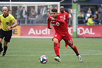 SEATTLE, WA - NOVEMBER 10: Alejandro Pozuelo #10 of Toronto FC runs with the ball during a game between Toronto FC and Seattle Sounders FC at CenturyLink Field on November 10, 2019 in Seattle, Washington.