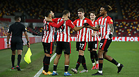 Brentford players congratulate Saman Ghoddos (far left) after scoring their second goal during Brentford vs Sheffield Wednesday, Sky Bet EFL Championship Football at the Brentford Community Stadium on 24th February 2021