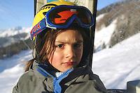 Switzerland. Valais. Crans Montana. Winter ski resort. Micaela Ruef sits in the the CMA ( Crans Montana Aminona) cable cars. © 2005 Didier Ruef