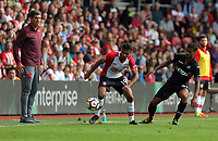 (L-R) Southampton manager Mauricio Pellegrino watches on as Sofiane Boufal of Southampton tries to avoid Kyle Naughton of Swansea City during the Premier League match between Southampton and Swansea City at the St Mary's Stadium, Southampton, England, UK. Saturday 12 August 2017