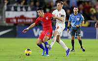ORLANDO, FL - NOVEMBER 15: Alfredo Morales #15 of the United States attempts to move with the ball past Scott Arfield #8 of Canada during a game between Canada and USMNT at Exploria Stadium on November 15, 2019 in Orlando, Florida.