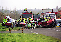 Firefighters attend a road traffic accident where two cars crashed head-on. They were in turn crashed into by on-coming traffic trapping both drivers.The firefighters are using hydraulic cutting tools to cut open the vehicle to allow access for the paramedics...© SHOUT. THIS PICTURE MUST ONLY BE USED TO ILLUSTRATE THE EMERGENCY SERVICES IN A POSITIVE MANNER. CONTACT JOHN CALLAN. Exact date unknown.john@shoutpictures.com.www.shoutpictures.com.....