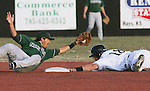 CHAD PILSTER · Hays Daily News<br /> <br /> Fort Hays State University's Shane Wade (18) is safe as Northwest Missouri State University's Cameron Bedard (11) misses the tag on Wednesday, March 13, 2013 at Larks Park in Hays, Kansas. Fort Hays State University played a double header against Northwest Missouri State University. This was the second game.