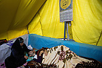 DOMIZ, IRAQ: A mother tends to her sick son in a tent in the Domiz refugee camp in the Kurdish region of northern Iraq. Both are refugees who fled the violence in Syria...The semi-autonomous region of Iraqi Kurdistan has accepted around 60,000 refugees from war-torn Syria. Around 20,000 refugees live in the Domiz camp which sits 60 km from the Iraq-Syria border...Photo by Younes Mohammad/Metrography