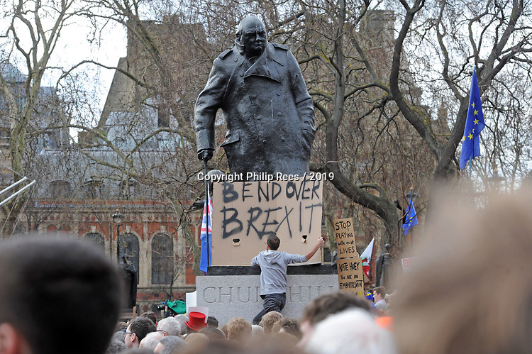 "A protester places a placard on the statue of Sir Winston Churchhill in Parliament Square, London during the ""Put it to the People"" rally which made it's way through central London today. Demonstrators from across the country gathered to call for a second referendum on Brexit and to march through the UK capital finishing with speeches in Parliament Square opposite the Houses of Parliament in Westminster."