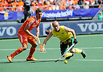 The Hague, Netherlands, June 15: Matthew Swann #20 of Australia fight for the ball while Jelle Galema #20 of The Netherlands looks on during the field hockey gold match (Men) between Australia and The Netherlands on June 15, 2014 during the World Cup 2014 at Kyocera Stadium in The Hague, Netherlands. Final score 6-1 (2-1)  (Photo by Dirk Markgraf / www.265-images.com) *** Local caption ***