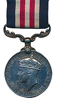 BNPS.co.uk (01202) 558833. <br /> Pic: Warwick&Warwick/BNPS<br /> <br /> Pictured: Lance Corporal Richard Holmes' Military Medal. <br /> <br /> The bravery medal awarded to a hero commando for his daring acts of sabotage in World War Two has been sold by his family for £92,000.<br /> <br /> Lance Corporal Richard 'Dick' Holmes led a daring attack by the Special Boat Service (SBS) on a fuel dump on German-occupied Crete in 1943.<br /> <br /> His small team sailed to the Greek island under cover of darkness and marched 100 miles over mountains carrying 70lbs of equipment each to their heavily guarded target.