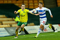 29th December 2020; Carrow Road, Norwich, Norfolk, England, English Football League Championship Football, Norwich versus Queens Park Rangers; Oliver Skipp of Norwich City takes on Tom Carroll of Queens Park Rangers along the line