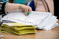 Pictured: Ballot papers being counted during The Swansea East and Gower Election Count at LC in Swansea, Wales, UK. Friday 07 May 2020