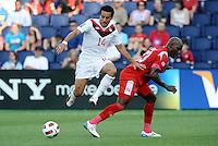 Dwayne De Rosario (14) Canada goes around Felipe Baloy  defender Panama...Canada and Panama tied 1-1 in Gold Cup play at LIVESTRONG Sporting Park, Kansas City, Kansas.