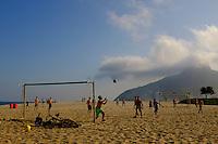 People play football in the sand on ipanema beach in Rio de Janeiro